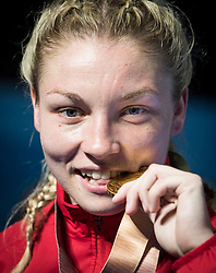 Wales' Lauren Price with her gold medal after winning the Women's Middle (69-75kg) final at Oxenford Studios during day ten of the 2018 Commonwealth Games in the Gold Coast, Australia.