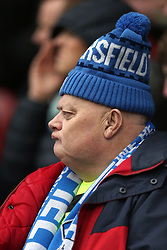 21 October 2017 Huddersfield: Premier League Football: Huddersfield Town v Manchester United: a Town fan proudly wearing his bobble hat.<br /> Photo: Mark Leech