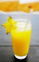 a glass of fruit orange juice
