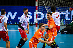 The Dutch handball player Kay Smits, Dani Baijens in action during the European Championship qualifying match against Turkey in the Topsport Center Almere.