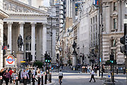 Pedestrians and traffic mingle at Bank junction, in front of Royal Exchange and up Cornhill Street in the City of London, the capital's financial district, on 21st September 2021, in London, England. Post-Covid pandemic, City workers are returning to their office desks in greater numbers but many still prefer to work from home for at least 1-2 days a week.