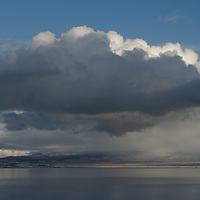 Clouds from a clearing winter storm swirl over Mono Lake, a saline inland sea east of the Sierra Nevada crest in California. For the last several decades Mono Lake was severely threatened by Los Angeles Department of Water and Power diversions of inflowing streams into an aqueduct.  Now, due to a court order that limits water diversion, the lake has slowly begun refilling.