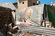 Beirut, Lebanon - September 18, 2010: A movie banner from the 2007 film Married Life, starring Pierce Brosnan, Rachel McAdams, Patricia Clarkson, and Chris Cooper, finds a second use as a wall in the Shatila refugee camp, a neighborhood of Beirut that is home to several thousand Palestinians.