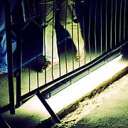 Light underneath barrier, London, England (October 2006)