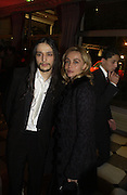 Olivier Theyskens and Emmanuelle Beart. The Sidaction Party raising funds to treat AIDS, held during Haute Couture week  Spring/Summer 2006 at the Pavillon D'Armenonville, Bois de Boulogne.  Paris.  January 25 2006.  ONE TIME USE ONLY - DO NOT ARCHIVE  © Copyright Photograph by Dafydd Jones 66 Stockwell Park Rd. London SW9 0DA Tel 020 7733 0108 www.dafjones.com