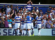 Charlie Austin (QPR striker) celebrating with his team mates after scoring to put QPR one up against Not Forest (Score 1-0) during the Sky Bet Championship match between Queens Park Rangers and Nottingham Forest at the Loftus Road Stadium, London, England on 12 September 2015. Photo by Matthew Redman.