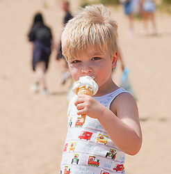 © Licensed to London News Pictures. /02/06/2021. Formby , UK. . Tobi,3, enjoys an ice-cream  on Formby Beach, Merseyside.Photo credit: Ioannis Alexopoulos/LNP <br /> <br /> **Permission Granted