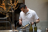 Executive Chef David Taylor prepares a dish of scallops with roasted fennel and Neapolitan chiles at A16 restaurant in San Francisco Thursday, November 17, 2011. The scallops will be one of the many courses offered on the restaurant's Christmas Eve Feast of the 7 Fishes, prix-fixe menu.
