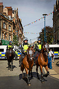 Police officers on horse back patrol the streets of Dover to keep apart members of Kent Anti Racism Network and far right facist groups who were also gathering to blockade the port of Dover on the 5th September 2020, Dover, Kent.  Members of Kent Anti Racism Network gathered today in Dover, Kent to stand in solidarity with those fleeing war, poverty and persecution making the extremely dangerous crossing to seek sanctuary in the UK.