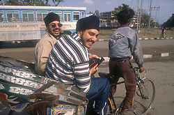 Tourists being carried on bicycle rickshaw in Chandigarh; India,