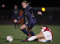 Arsenal Women's Katie McCabe (right) and Manchester United Women's Kirsty Smith battle for the ball