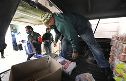 South Africa - Cape Town - 1 September 2020 - Gift of the Givers operations manager Ali Sablay, Chipo Mangora and Rashied Prince unload the donations. Gift of the Givers handed over a month's supply of food, hygiene and other supplies to the Ons Plek shelter for girls who previously stayed on the streets. The shelter is facing a lot of financial difficulties with downsizing and even closure on the table.Photographer: Armand Hough/African News Agency(ANA)