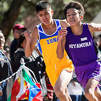 100414       Cable Hoover<br /> <br /> Miyamura Patriot Nicholas Jameson and Zuni Thunderbird Tre Riley battle it out for a second place in the Gallup Invitational cross country meet at Red Rock Park Saturday.