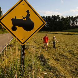 Walking in a field on a farm in Pepperell, Massachusetts. Tractor crossing.