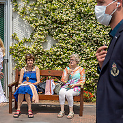PARIS, FRANCE June 12.  Two ladies enjoy ice lollies on a park bench in the grounds of Roland Garros during competition at the 2021 French Open Tennis Tournament at Roland Garros on June 12th 2021 in Paris, France. (Photo by Tim Clayton/Corbis via Getty Images)
