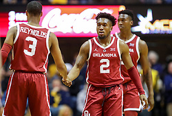 Feb 2, 2019; Morgantown, WV, USA; Oklahoma Sooners guard Aaron Calixte (2) and Oklahoma Sooners guard Miles Reynolds (3) talk during the second half against the West Virginia Mountaineers at WVU Coliseum. Mandatory Credit: Ben Queen-USA TODAY Sports