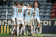 Huddersfield players celebrate their second goal in front of the fans during the Sky Bet Championship match between Huddersfield Town and Rotherham United at the John Smiths Stadium, Huddersfield, England on 15 December 2015. Photo by Mark P Doherty.