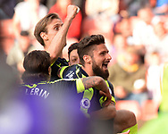 Mersut Ozil of Arsenal © celebrates with teammate and fellow scorer Olivier Giroud ® after he scores his teams 2nd goal. Premier league match, Stoke City v Arsenal at the Bet365 Stadium in Stoke on Trent, Staffs on Saturday 13th May 2017.<br /> pic by Bradley Collyer, Andrew Orchard sports photography.