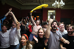 © Licensed to London News Pictures. 29/06/2021. London, UK. Fans react at The Salisbury Hotel in north London, after England's Harry Kane scores a goal, in their Euro 2020 football match against Germany. Photo credit: Dinendra Haria/LNP