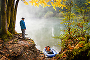 Angler David Page gets ready to launch his raft. Vancouver Island, BC