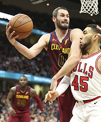 October 24, 2017 - Cleveland, OH, USA - The Cleveland Cavaliers' Kevin Love dives over the Chicago Bulls' Denzel Valentine (45) to keep the ball in bounds during the third quarter on Tuesday, Oct. 24, 2017, at Quicken Loans Arena in Cleveland. The Cavs won, 119-112. (Credit Image: © Phil Masturzo/TNS via ZUMA Wire)