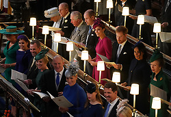 (left to right back row) Queen Elizabeth II, the Duke of Edinburgh, the Prince of Wales, the Duke of Cambridge, the Duchess of Cambridge, the Duke of Sussex, the Duchess of Sussex and the Princess Royal, (left to right front row) Sarah Ferguson, Princess Beatrice, Peter Phillips, Autumn Phillips, Mike Tindall, Zara Tindall, Lady Louise Mountbatten-Windsor and Crown Prince Pavlos of Greece at the wedding of Princess Eugenie to Jack Brooksbank at St George's Chapel in Windsor Castle.