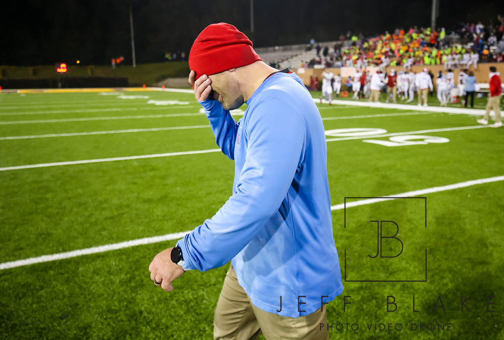 AC Flora Falcons head coach Dustin Curtis fights back tears following their State Championship win over the North Myrtle Beach Chiefs at Benedict College.