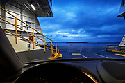 Image from the ferry to Vashon Island, Porsche Cayenne in foreground, Seattle, Washington, Pacific Northwest by Randy Wells