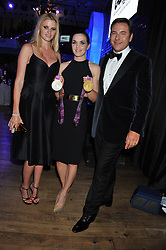 Left to right, LARA STONE, VICTORIA PENDLETON and DAVID WALLIAMS at the GQ Men of The Year Awards 2012 held at The Royal Opera House, London on 4th September 2012.