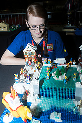 The SEC in Glasgow hosts Brick Live, the largest LEGO exhibition in the UK. Featuring models made up of over 6 million bricks, LEGO enthusiasts can build their own creations as well as admiring the models created by some of the leading designers including Scotland's Nick Clayton and Rocco Buttliere from Chicago.<br /> <br /> Pictured: Moel builder Alison Clayton looking onto an Ice Skating scene made from LEGO