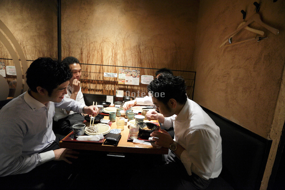 young businessmen together eating Tokyo Ginza