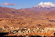 BOLIVIA, LA PAZ, SKYLINE in a valley below Mount Illimani