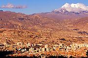 BOLIVIA, LA PAZ, SKYLINE in a valley below Mount Illimani