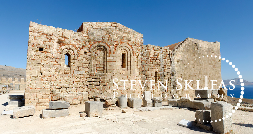 Rhodes. Greece. The 13th century Byzantine church of St John (Agios Ioannis) inside the  114 metre high Acropolis hill of Lindos. Lindos is located on the east coast of the island of Rhodes which is the largest of the Dodecanese Island group and one of the most popular Greek Islands.