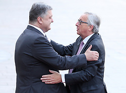 July 13, 2017 - Kiev, Ukraine - Ukrainian President Petro Poroshenko and European Commission President Jean-Claude Juncker embrace before the EU-Ukraine summit in Kiev. Ukraine,Thursday, July 13, 2017. (Credit Image: © Danil Shamkin/NurPhoto via ZUMA Press)