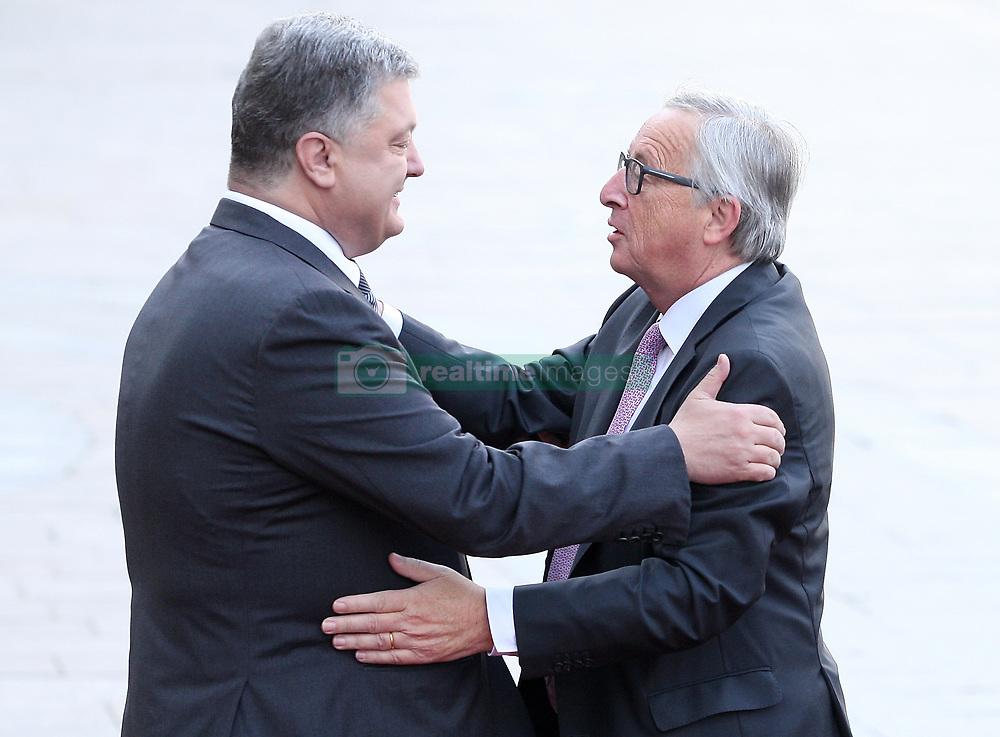 July 13, 2017 - Kiev, Ukraine - Ukrainian President Petro Poroshenko and European Commission President Jean-Claude Juncker embrace before the EU-Ukraine summit in Kiev. Ukraine,Thursday, July 13, 2017. (Credit Image: © Danil Shamkin/NurPhoto via ZUMA Press)