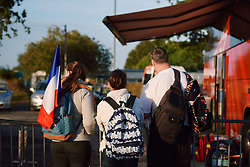A few fans gather behind the barriers of team parking at the 2020 UEC Road European Championships - Under 23 Women Road Race, a 81.9 km road race in Plouay, France on August 26, 2020. Photo by Sean Robinson/velofocus.com