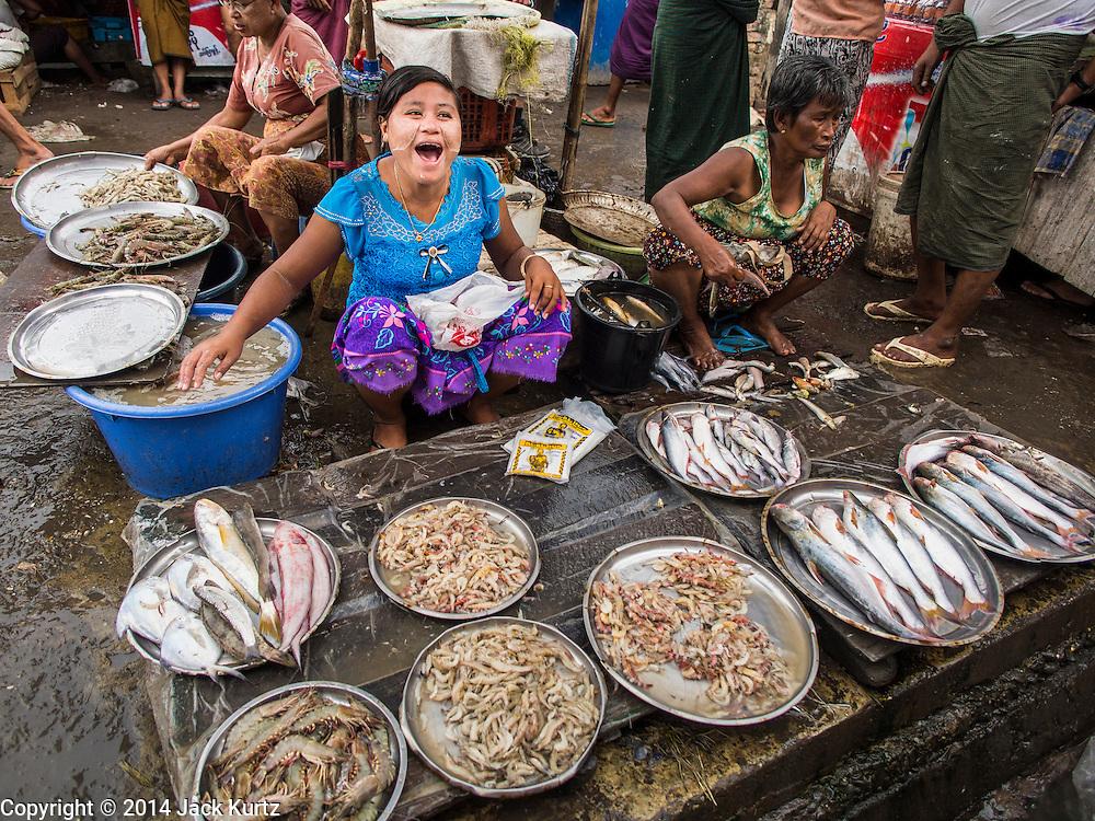 08 NOVEMBER 2014 - SITTWE, RAKHINE, MYANMAR:  A woman sells fresh fish in the market in Sittwe. Sittwe is a small town in the Myanmar state of Rakhine, on the Bay of Bengal.  PHOTO BY JACK KURTZ