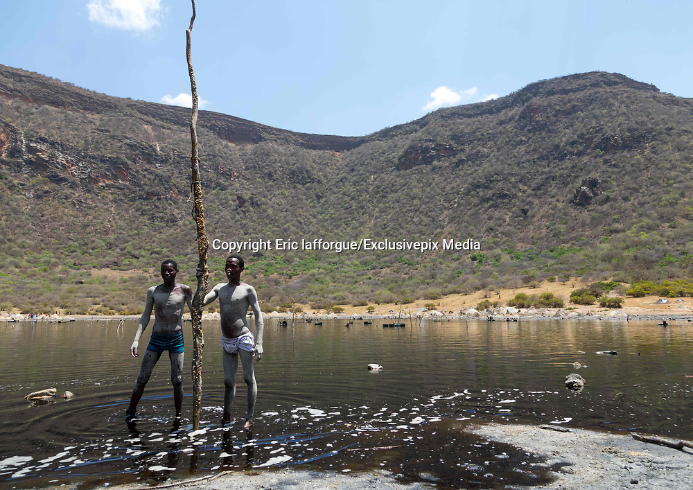 EL SOD: THE SALT OF LIFE<br />  <br />  El Sod, the House Of Salt, is a village located 90 km from Yabelo, the capital of Borana people in South Ethiopia. It stands on the edge of an extinct volcano wide of 1,8 km diameter, with a salted lake in the crater. For centuries, men dive into the lake to collect the salt and sell it across Ethiopia, Somalia and Kenya<br /> <br />  It takes 1 hour on a narrow path to go down the 2,5 km from the village to the lake, 340 meters lower. The best view on the crater can be spotted from the recently built mosque.<br /> Every miner works as a free lance, independent from any company or boss. Most of the time divers are naked, the salted water being so agressive that it destroys everything, including clothes and shoes.<br />  Miners try to protect their nose and ears with plugs made of soil wrapped in plastic bags. There's no protection for the eyes: many suffer heavily from blindness.<br />  When the weather is good after rains (Borana wait for it for months since the area suffers from drought) more than 200 men dive into the lake. More and more children are joining for the families to get some extra revenue. The parents are aware of the dangers but they don't have any choice if they want to survive.<br /> ©Eric lafforgue/Exclusivepix Media