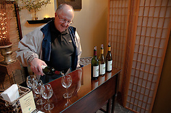 California: Napa City, Grgich Hills Winery man pours wine for patron of Napa B&B Holiday Tour at Inn on Randolph.Photo copyright Lee Foster.  Photo # canapa106879