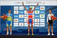 Sykkel<br /> VM 2012<br /> 17.09.2012<br /> VM-gull tempo til Oskar Svendsen fra Lillehammer<br /> Foto: PhotoNews/Digitalsport<br /> NORWAY ONLY<br /> <br /> VALKENBURG, THE NETHERLANDS - SEPTEMBER 17: Oskar Svendsen of Norway raise his hands during the podium ceremony after the 2012 UCI Road World Championships Individual Time Trial Race for Men Juniors , Matej Mohoric of Slovenia became second and Maximilian Schachmann from Germany thirth on September 17, 2012 in Valkenburg, The Netherlands.