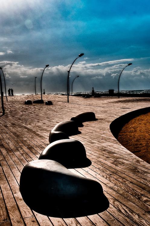 Sculptures lamp posts deck on Tel-Aviv beach promenade