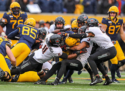 Nov 23, 2019; Morgantown, WV, USA; Oklahoma State Cowboys safety Tre Sterling (3) and Oklahoma State Cowboys linebacker Amen Ogbongbemiga (11) stop a run from West Virginia Mountaineers running back Leddie Brown (4) during the fourth quarter at Mountaineer Field at Milan Puskar Stadium. Mandatory Credit: Ben Queen-USA TODAY Sports