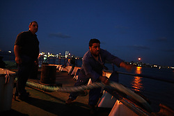 Chief Engineer Gaby Jarjour, left, and A/B Seaman Fadi Joubili, right, dock the Bisanzio so it can be loaded in Port Said, Egypt on April 8, 2008. The Bisanzio, a feeder ship taking containers from Port Said to Beirut, is Lebanese owned but flies a St. Vincent flag. The Suez Canal is one of the most important shipping routes in the world, as it allows allows two-way water transportation - most importantly between Europe and Asia without the circumnavigation of Africa.
