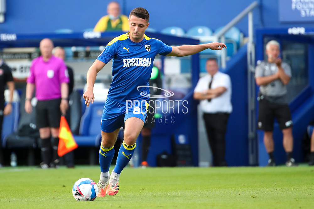 AFC Wimbledon midfielder Anthony Hartigan (8) passing the ball during the EFL Trophy Group O match between AFC Wimbledon and Charlton Athletic at the Kiyan Prince Foundation Stadium, London, England on 1 September 2020.