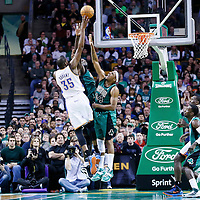 23 November 2012: Oklahoma City Thunder small forward Kevin Durant (35) takes a jumpshot over Boston Celtics power forward Kevin Garnett (5) and Boston Celtics small forward Paul Pierce (34) during the Boston Celtics 108-100 victory over the Oklahoma City Thunder at the TD Garden, Boston, Massachusetts, USA.