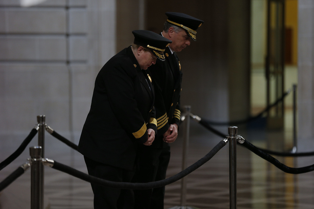 From left: Fire Department chief Joanne Hayes-White and deputy chief of operations Mark Gonzales pay their respect as San Francisco Mayor Ed Lee lies in state at City Hall on Friday, Dec. 15, 2017, in San Francisco, Calif. Lee died on Tuesday from a heart attack. He was 65 years old.