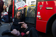 Inspired by Swedish teenager Greta Thunberg and organised by Youth Strike 4 Climate, British eco-aware school and college-age pupils protest about Climate Change stop traffic in Parliament Square during their walkout from classes, on 15th February 2019, in Westminster, London England.