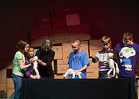 "Madeline Tredo, Jade Pickowicz, Artist in Residence Bonnie Periale, Brian Tremblay, Mathieu Sherburn and Joe Laurendeau depict life in Pompeii during their puppet performance of ""Scenes from Ancient Pompeii"" at Gilmanton Elementary School Wednesday afternoon.   (Karen Bobotas/for the Laconia Daily Sun)"