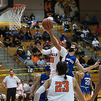 Gallup Bengal Joaquin Ortega (30) drives to the basket during a varsity basketball game against the Bloomfield Bobcats Tuesday evening at Gallup High School in Gallup.
